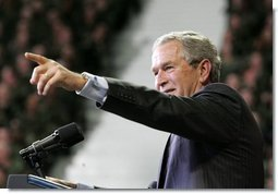 President George W. Bush takes one of many questions from an enthusiastic audience during his remarks on the War on Terror at Kansas State University in Manhattan, Kan., Monday, Jan. 23, 2006.  White House photo by Eric Draper
