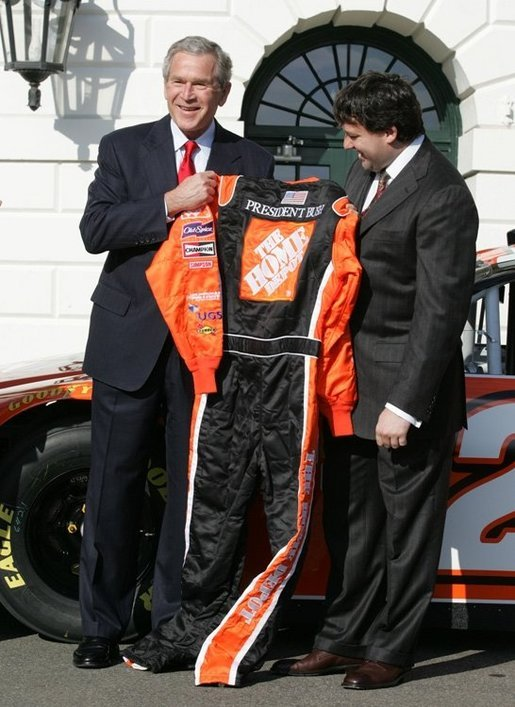 President George W. Bush is presented with his own racing suit by 2005 NASCAR Nextel Cup Champion Tony Stewart, Tuesday, Jan. 24, 2006 on the South Lawn at the White House. White House photo by Eric Draper
