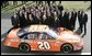 President George W. Bush poses with 2005 NASCAR Nextel Cup Champion team and their car, Tuesday, Jan. 24, 2006 on the South Lawn driveway at the White House. White House photo by Eric Draper
