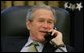 President George W. Bush talks on the phone with Canadian Prime Minister-elect Stephen Harper, in the Oval Office, Wednesday morning, Jan. 25, 2006. White House photo by Paul Morse