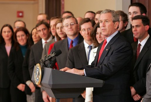 "President George W. Bush stands with former law clerks of Judge Samuel Alito as he delivers a statement in the Dwight D. Eisenhower Executive Office Building Wednesday, Jan. 25, 2006. ""All these brilliant legal minds are united in their strong support of Sam Alito, And in his confirmation hearings, the American people saw why. Judge Alito is open-minded and principled,"" said the President. ""He gives every case careful attention, and he makes decisions based on the merits. Judge Alito understands that the role of a judge is to interpret the law, not to advance a personal or political agenda."" White House photo by Paul Morse"