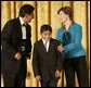 Laura Bush congratulates Jose Fernando Salas, left, and Carlos Gabriel Pascual from the Art and Children Program of Veracruz, Mexico, at their award presentation Wednesday, Jan. 25, 2006 in the East Room of the White House, during the President's Committee on the Arts and the Humanities 2006 Coming Up Taller Awards ceremony. White House photo by Shealah Craighead