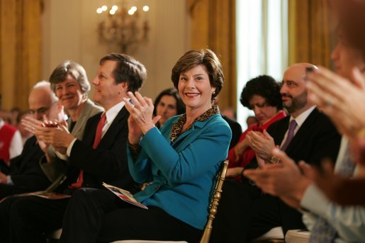 Laura Bush applauds The Moving in the Spirit dancers performance Wednesday, Jan. 25, 2006 in the East Room of the White House, during the President's Committee on the Arts and the Humanities 2006 Coming Up Taller Awards ceremony. White House photo by Paul Morse