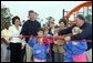 Laura Bush attends a ribbon cutting ceremony with football star Brett Favre and his wife, Deanna, left, Secretary Margaret Spellings, center, Dan Vogel, Associate Director, USA Freedom Corps, right, and student of Hancock North Central Elementary Shool at the Kaboom Playground, built at the Hancock North Central Elementary School in Kiln, Ms., Wednesday, Jan. 26, 2006, during a visit to the area ravaged by Hurricane Katrina. White House photo by Shealah Craighead