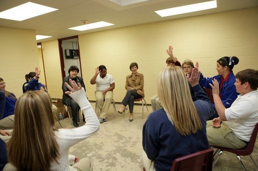 Laura Bush and U.S. Secretary of Education Margaret Spellings meet with staff and students Wednesday, Jan. 26, 2006 at the St. Bernard Unified School in Chalmette, La. Students raise their hands to acknowledge that their families lost everything in the storms of Hurricane Katrina. White House photo by Shealah Craighead