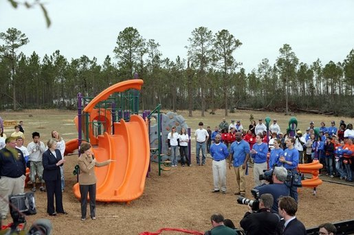 Laura Bush addresses a gathering to dedicate the new Kaboom Playground, built at the Hancock North Central Elementary School in Kiln, Ms., Wednesday, Jan. 26, 2006, during a visit to the area ravaged by Hurricane Katrina. White House photo by Shealah Craighead