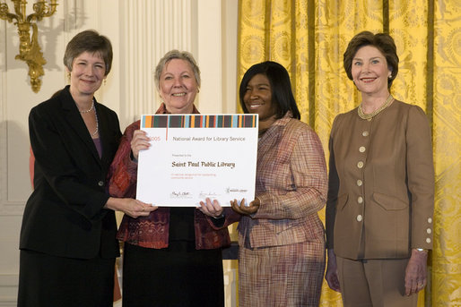 Laura Bush along with Mary Chute, Acting Director, Institute of Museums and Library Services, left, presents the 2005 National Awards for Museum and Library Services awards to St Paul Public Library Director, Kathleen Flynn, and Community Representative, Regina Harris, during a ceremony at the White House January 30, 2006. The Institute of Museum and Library Services' National Awards for Museum and Library Service honor outstanding museums and libraries that demonstrate an ongoing institutional commitment to public service. It is the nation's highest honor for excellence in public service provided by these institutions. White House photo by Shealah Craighead