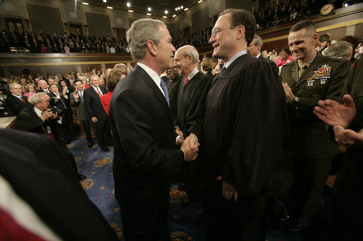 President George W, Bush shakes hands with newly confirmed U.S. Supreme Court Justice Samuel Alito, Tuesday, Jan. 31, 2006 at the State of the Union Address at the United States Capitol. White House photo by Eric Draper