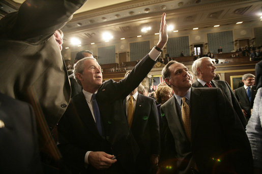President George W. Bush waves toward the upper visitors gallery of the House Chamber following his State of the Union remarks Tuesday, Jan. 31, 2006 at the United States Capitol. White House photo by Eric Draper
