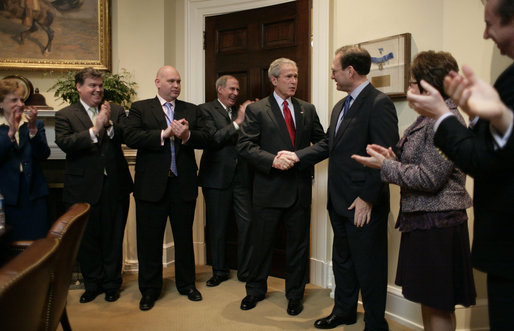 President George W. Bush shakes hands with Judge Samuel A. Alito in the Roosevelt Room of the White House Tuesday, Jan. 31, 2006, after the Senate voted to confirm Judge Alito as the 110th Justice of the Supreme Court. Looking on, from left, are: Harriet Miers, Counsel to the President; Bill Kelley, Deputy Counsel to the President; Steve Schmidt, Deputy Assistant to the President and former Senator Dan Coats (R-Ind.). At right are Mrs. Martha Ann Alito and Ed Gillespie. White House photo by Eric Draper
