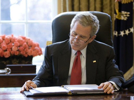 President George W. Bush reads over a draft of his State of the Union speech in the Oval Office Tuesday morning, Jan. 31, 2006, in preparation for the annual address to the nation scheduled for this evening. White House photo by Eric Draper