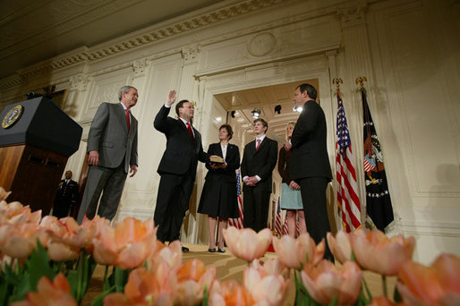 President George W. Bush, left, looks on during the swearing-in ceremony for U.S. Supreme Court Justice Samuel A. Alito, Tuesday, Feb. 1, 2006 in the East Room of the White House, sworn-in by U.S. Supreme Court Chief Justice John Roberts. Altio's wife, Martha-Ann, their son Phil and daughter, Laura, are seen center-background. White House photo by Paul Morse