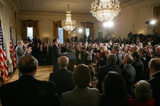 President George W. Bush, left, listens as newly confirmed U.S. Supreme Court Justice Samuel Alito addresses an audience, Tuesday, Feb. 1, 2006 in the East Room of the White House, prior to being sworn-in by U.S. Supreme Court Chief Justice John Roberts. White House photo by Paul Morse