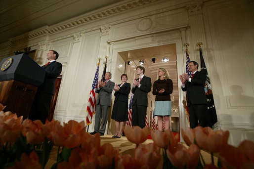 President George W. Bush, left, applauds as he listens to newly confirmed U.S. Supreme Court Justice Samuel Alito address an audience, Tuesday, Feb. 1, 2006 in the East Room of the White House, prior to being sworn-in by U.S. Supreme Court Chief Justice John Roberts, right. President Bush stands with Alito's wife, Martha-Ann, their son, Phil and daughter, Laura. White House photo by Paul Morse