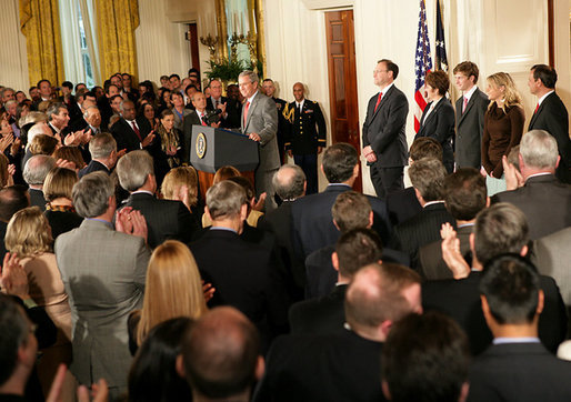 President George W. Bush welcomes an audience to the swearing-in ceremony for U.S. Supreme Court Justice Samuel A. Alito, Tuesday, Feb. 1, 2006 in the East Room of the White House, joined by Altio's wife, Martha-Ann, their son Phil, daughter, Laura, and U.S. Supreme Court Justice John Roberts. White House photo by Shealah Craighead
