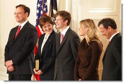 U.S. Supreme Court Justice Samuel A. Alito is seen, Tuesday, Feb. 1, 2006 in the East Room of the White House, with his wife, Martha-Ann, their son Phil, daughter, Laura, and U.S. Supreme Court Chief Justice John Roberts prior to being sworn-in.  White House photo by Shealah Craighead