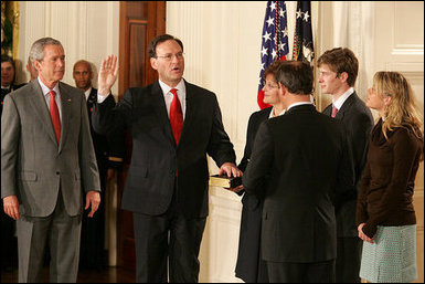 President George W. Bush looks on during the swearing-in ceremony for U.S. Supreme Court Justice Samuel A. Alito, Tuesday, Feb. 1, 2006 in the East Room of the White House, sworn-in by U.S. Supreme Court Chief Justice John Roberts. Alito's wife, Martha-Ann, their son Phil and daughter, Laura, are seen to the right. White House photo by Shealah Craighead