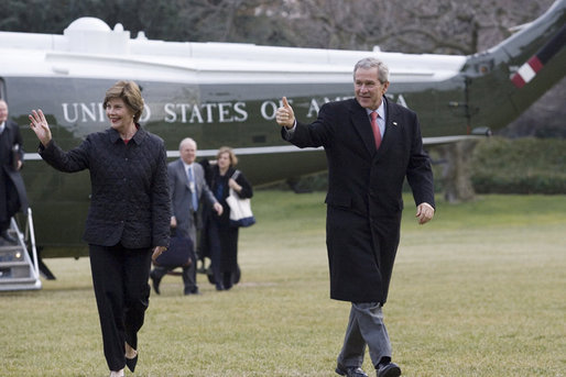 President George W. Bush and Laura Bush arrive on the South lawn at the White House returning from delivering remarks on the 2006 agenda in Nashville, Tennessee, Wednesday, Feb. 1, 2006. White House photo by Shealah Craighead