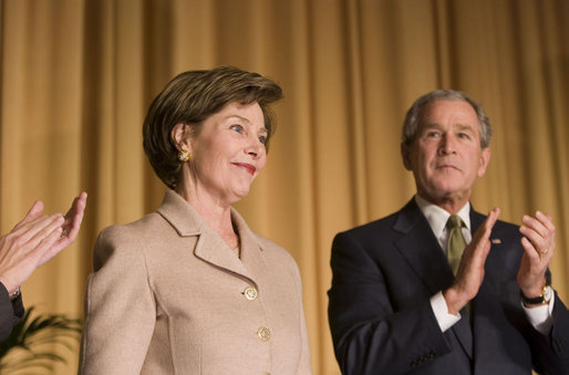 Mrs. Laura Bush acknowledges applause from President George W. Bush and the audience Thursday, Feb. 2, 2006, as she's introduced during the National Prayer Breakfast at the Hilton Washington Hotel. White House photo by Paul Morse