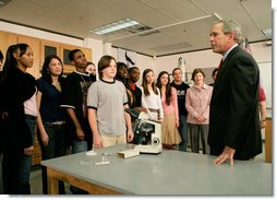 President George W. Bush speaks with science and engineering students after touring the Yvonne A. Ewell Townview Magnet Center in Dallas, Texas, Friday, Feb. 3, 2006. White House photo by Eric Draper