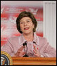 Mrs. Laura Bush addresses an audience Friday, Feb. 3, 2006 in Rio Rancho, New Mexico, reminding people of the proclamation signed by President George W. Bush earlier in the day making February American Heart Month, and encouraging Americans to remember that heart disease is the number one killer and to take efforts through healthy eating, exercise and regular check-ups to prevent heart disease. White House photo by Eric Draper