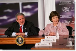 President George W. Bush and Mrs. Laura Bush participate in panel on American competitiveness Friday, Feb. 3, 2006, during a visit to Intel Corporation in Rio Rancho, N.M.  White House photo by Eric Draper