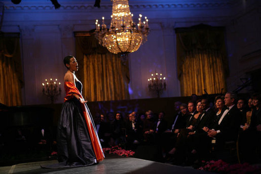 President George W. Bush and Laura Bush listen to soprano Harolyn Blackwell perform in the East Room of the White House during a dinner in honor of The Dance Theatre of Harlem Monday, February 6, 2006. White House photo by Shealah Craighead