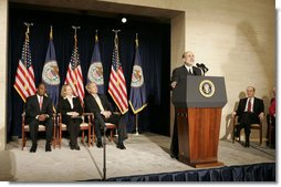 With his predecessor, Alan Greenspan, looking on, Chairman Ben Bernanke addresses President George W. Bush and others after being sworn in to the Federal Reserve post. Also on stage with the President are Mrs. Anna Bernanke and Roger W. Ferguson, Jr., Vice Chairman of the Federal Reserve.  White House photo by Kimberlee Hewitt