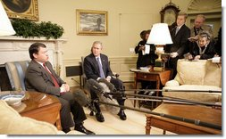 President George W. Bush listens as King Abdullah of Jordan makes remarks Wednesday, Feb. 8, 2006, during a photo opportunity in the Oval Office. The two leaders took the opportunity to urge an end to recent violence over caricatures of the Prophet Mohammed.  White House photo by Eric Draper