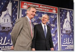 President George W. Bush stands with New Hampshire U.S. Senator Judd Gregg prior to addressing his remarks on the 2007 Budget and the Deficit Reduction Act of 2005, in a speech to the Business and Industry Association of New Hampshire, Wednesday, Feb. 8, 2006 in Manchester, N.H.  White House photo by Paul Morse