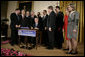 President George W. Bush is joined by legislators Wednesday, Feb. 8, 2006 at the signing ceremony for S. 1932, The Deficit Reduction Act of 2005, in the East Room of the White House. White House photo by Eric Draper