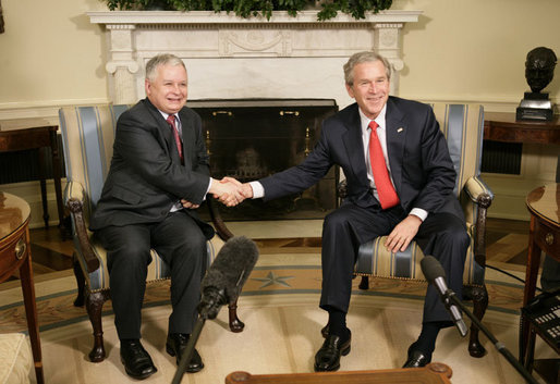 President George W. Bush welcomes Poland's President Lech Kaczynski to the Oval Office at the White House, Thursday, Feb. 9, 2006 in Washington. White House photo by Eric Draper