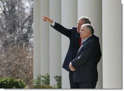 President George W. Bush shows Poland's President Lech Kaczynski points of interest around the White House from the Rose Garden steps outside the Oval Office, Thursday, Feb. 9, 2006 in Washington.  White House photo by Eric Draper