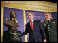 President George W. Bush admires a bust of himself presented in his honor Thursday, Feb. 9, 2006 at the National Guard Memorial Building in Washington, where President Bush talked about the global war on terror. White House photo by Paul Morse