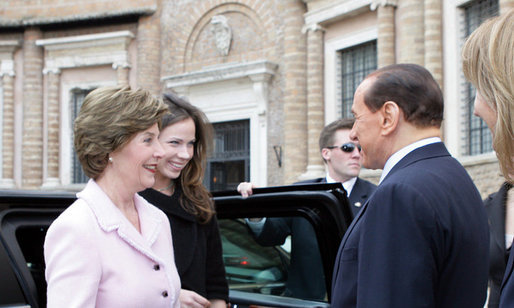 Mrs. Laura Bush and daughter, Barbara Bush, are greeted on their arrival by Italian Prime Minister Silvio Berlusconi, Thursday, Feb. 9, 2006 to the Villa Madama in Rome. White House photo by Shealah Craighead