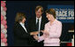 Mrs. Laura Bush presents the first Komen Italia Award, Thursday, Feb. 9, 2006 to Mrs. Marisa Giannini, a cancer survivor and the director of the Philatelic division of the Italian Postal Service, for her volunteer services with Koman Italia of The Susan G. Komen Breast Cancer Foundation. White House photo by Shealah Craighead