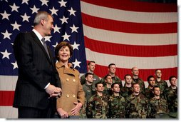 Laura Bush stands with U.S Ambassador to Italy Ron Spogli before speaking with troops during a visit to Aviano Air Base, in Aviano, Italy, Friday, Feb. 10, 2006. White House photo by Shealah Craighead