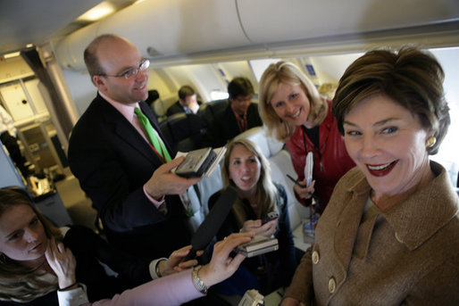Laura Bush talks with members of the press aboard her plane en route to Turin, Italy, Friday, Feb. 10, 2006. White House photo by Shealah Craighead
