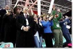 Laura Bush, her daughter, Barbara, and members of the U.S. Olympic Delegation, cheer on American Speed Skater Chad Hedrick Saturday, Feb. 11, 2006, during his heat at the 2006 U.S. Winter Olympics, in Turin, Italy. Hedrick went on to win the first gold medal for the United States.  White House photo by Shealah Craighead