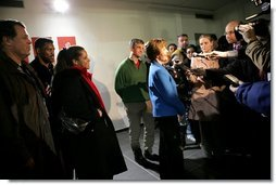 Laura Bush flanked by members of the U.S. Olympic Delegation, (from left) Roland Betts, Dr. Debi Thomas, Herschel Walker and Dr. Eric Heiden meet with members of the press after watching the Men's U.S. Speed Skating competition at the 2006 Winter Olympics in Turin, Italy.  White House photo by Shealah Craighead