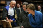 Laura Bush looks at an Ancient Thesis of Montichelli during a tour given by Paolo Novaria, Archives, left, at the University of Turin Saturday, Feb. 11, 2006, in Turin, Italy. White House photo by Shealah Craighead