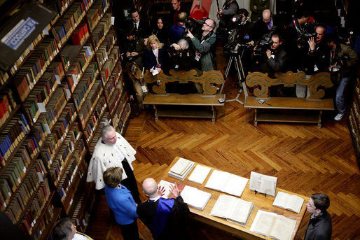 Laura Bush looks at an Ancient Thesis of Montichelli during a tour given by Enrico Artifoni, right, Paolo Novaria, right, and Andrea Carosso at the University of Turin Saturday, Feb. 11, 2006, in Turin, Italy. White House photo by Shealah Craighead