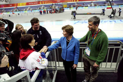 Laura Bush and former Olympian Dr. Eric Heiden meets with the family and parents of US speed skater Chad Hedrick after Hedrick finished first place in his heat taking the first US gold medal in the 2006 Winter Olympics in Turin, Italy. White House photo by Shealah Craighead