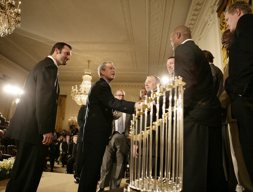 President George W. Bush welcomes Chicago White Sox players to the White House, Monday, Feb. 13, 2006 during an East Room ceremony to honor the 2005 World Series Champions. The World Series Trophy is seen foreground. White House photo by Eric Draper