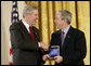 President George W. Bush presents a National Medal of Technology, Monday, Feb. 13, 2006 to Henry L. Nordoff, president, chairman and CEO of Gen-Probe Incorporated of San Diego, Calif., during ceremonies in the East Room of the White House. White House photo by Eric Draper
