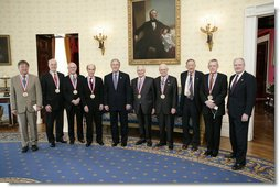 President George W. Bush and the Dr. John Marburger, far-right, director of the White House Office of Science and Technology, pose with the recipients of National Medal of Science, Monday, Feb. 13, of the White House. From left to right are Dr. Dennis P. Sullivan, Dr. Phillip A. Sharp, Dr. Robert N. Clayton, Dr. Stephen J. Lippard, Dr. Kenneth J. Arrow, Dr. Norman E. Borlaug, Dr. Edwin N. Lightfoot and Dr. Thomas E. Starzl. White House photo by Eric Draper