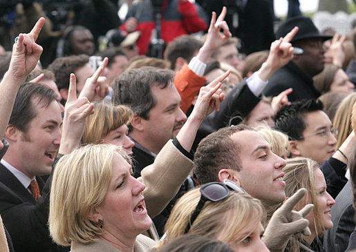 The crowd gives the 'Hook Em Horns' sign, Tuesday, Feb. 14, 2006 on the South Lawn of the White House, during ceremonies to honor the 2005 NCAA Football Champion University of Texas Longhorns. White House photo by Kimberlee Hewitt
