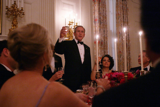 President George W. Bush offers a toast to his guests Tuesday evening, Feb. 14, 2006 during a Valentine's Day social dinner in the State Dining Room at the White House. White House photo by Kimberlee Hewitt