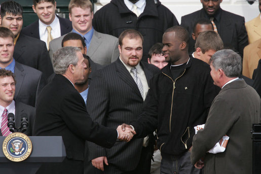 President George W. Bush welcomes University of Texas Longhorns star quarterback Vince Young to the White House, Tuesday, Feb. 14, 2006, during ceremonies to honor the 2005 NCAA Football Champions. White House photo by Paul Morse