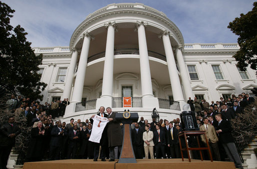 President George W. Bush holds up a University of Texas Longhorns jersey with head football coach Mack Brown, Tuesday, Feb. 14, 2006 on the South Lawn of the White House, during ceremonies to honor the 2005 NCAA Football Champions. White House photo by Paul Morse
